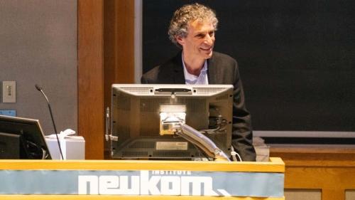 Professor Dan Rockmore speaking at a podium.